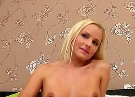 Smoking hot babe gets naked and rubs her tits