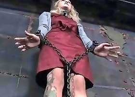 Chaied and tied up woman shows her sweet tattoos BDSM