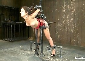 Cute slut fucked by machines in bondage scene