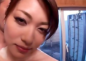 Akari Hoshino lets two guys soap her tits and nice butt