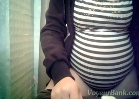 White pregnant lady in the public restroom filmed on hidden cam