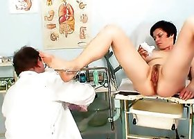 Mature brunette woman gets her pussy examined in a hospital