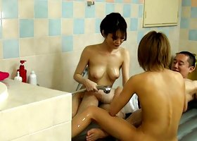Lovely and cute japanese chicks are washing his dick