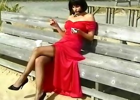 Spicy beauty in red dress is masturbating