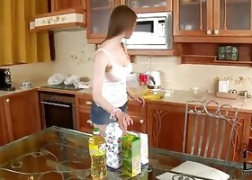 Tender Beata Undine Eating Fruits in the Kitchen