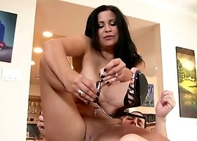 A busty milf is opening her legs up in the kitchen to be loved