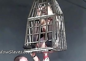 Caged blonde slave is cruelly burned with big red candles