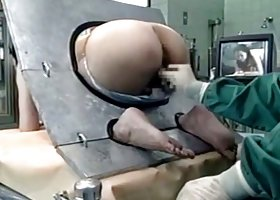 Asian big ass MILF  in a machine takes an enema pretty well