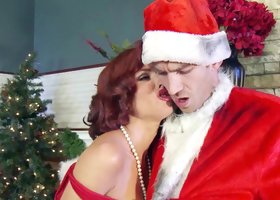 A redhead with large boobs is getting a Santa's cock in her cunt