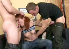 Ginger cowgirl called Amber works on impressively big cocks for orgasm