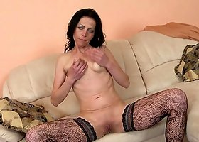 Saggy tits mature babe in lingerie fucking a dildo